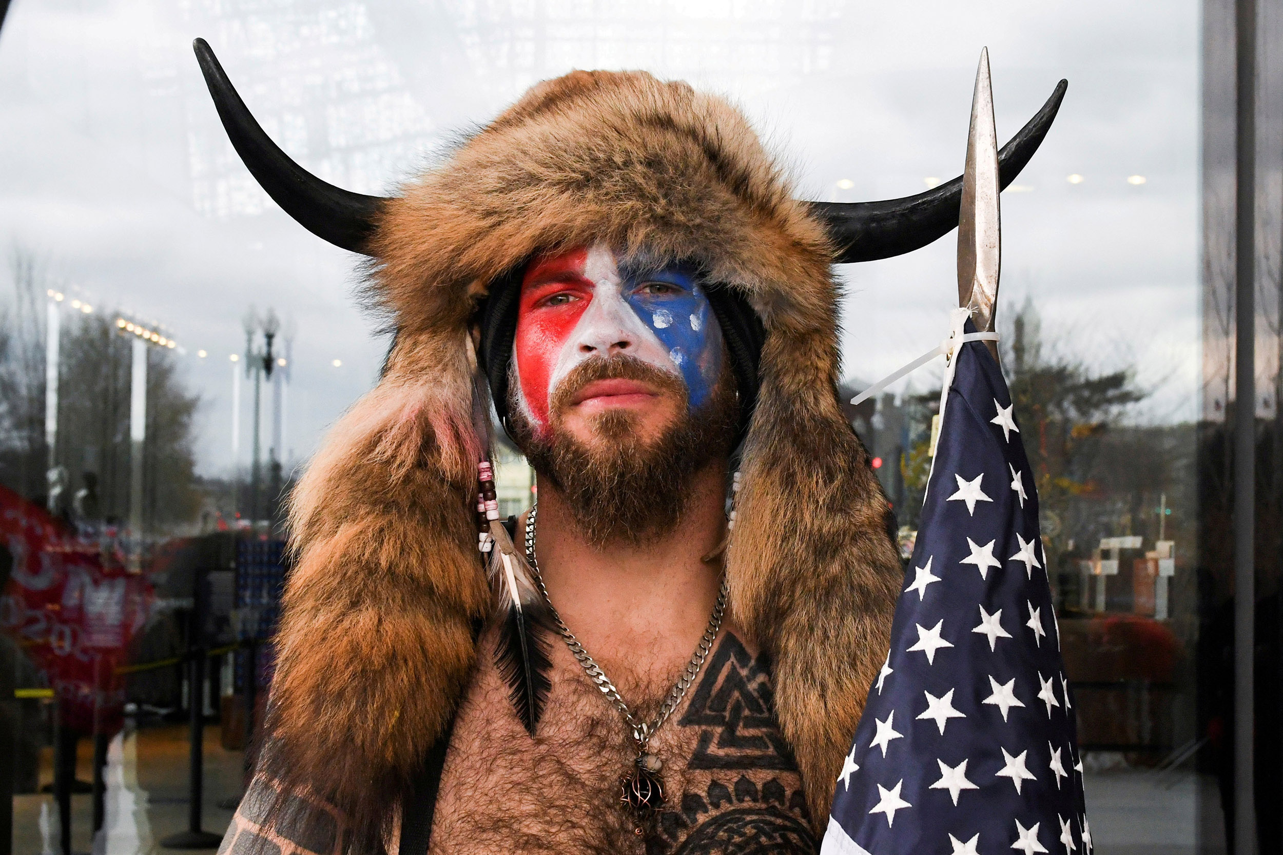 Image: FILE PHOTO: Man poses with his face painted in the colors of the U.S. flag in Washington